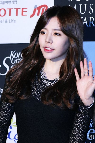 Tags: K-Pop, Girls' Generation, Sunny, Necklace, Black Background, Ring, Checkered Background, Black Dress, Black Outfit, Text: Brand Name, Light Background, Wave