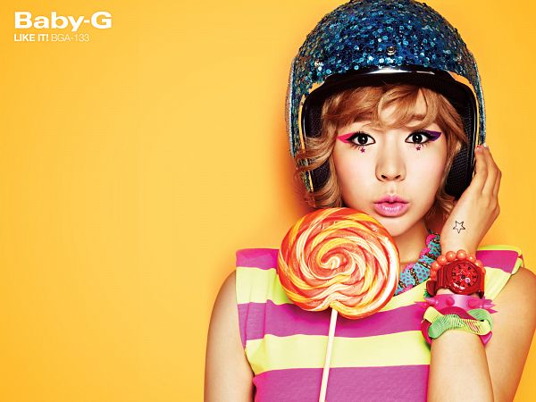 Tags: K-Pop, Girls' Generation, Sunny, Yellow Background, Tattoo, Helmet, Close Up, Hand On Hat, Watch, Striped Shirt, Text: Brand Name, Candy