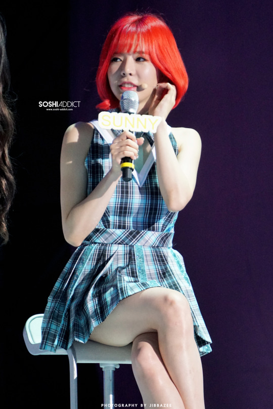 Tags: K-Pop, Girls' Generation, Sunny, Blue Outfit, Text: Artist Name, Red Hair, Checkered Dress, Sitting On Chair, Chair, Crossed Legs, Looking Away, Blue Dress