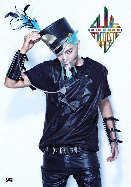 Tags: K-Pop, BIGBANG, T.O.P., Text: Company Name, Hand On Hat, Blue Hair, Face Mask, Top Hat, Leather Pants, Text: Song Title, Black Headwear, Necklace