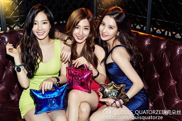 Tags: K-Pop, TaeTiSeo, Girls' Generation, Kim Tae-yeon, Seohyun, Stephanie Young Hwang, Bracelet, Sitting On Couch, Gold Bag, Trio, Crossed Legs, Wavy Hair