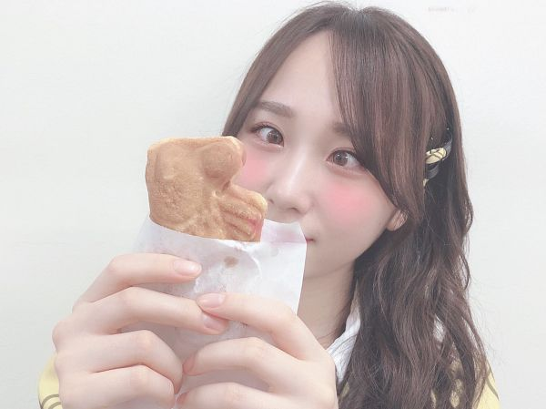 Tags: J-Pop, AKB48, Takahashi Juri, Holding Object, Covering Mouth, Light Background, Looking Ahead, White Background, Food, Yellow Shirt