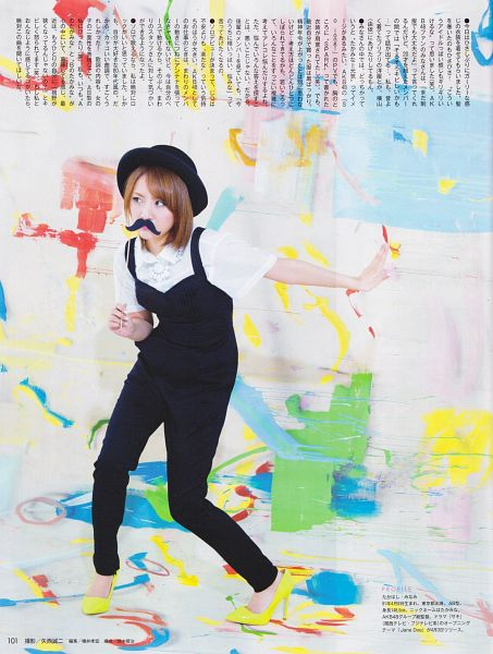Tags: J-Pop, AKB48, Takahashi Minami, Medium Hair, Black Headwear, Black Outfit, High Heels, Yellow Footwear, Light Background, Hat, Covering Mouth, White Background