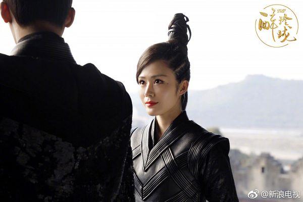 Tags: C-Drama, Tang Jingmei, Single Bun, Text, Text: Series Name, Black Shirt, Facial Mark, Hair Buns, Logo, Chinese Text, Hair Up, Mole