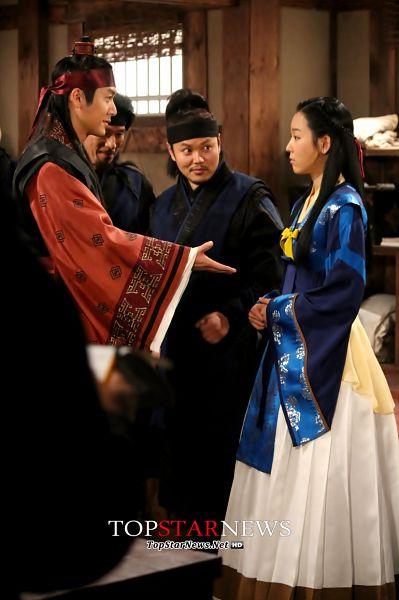 Tags: K-Drama, Jo Hyun-jae, Kim Min-gyo, Seo Hyun-jin, Korean Clothes, Blue Shirt, Hold Out Hand, Looking At Another, White Skirt, Skirt, Traditional Clothes, The King's Daughter Su Baek-hyang