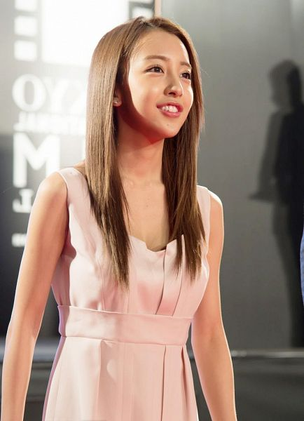 Tags: J-Pop, AKB48, Tomomi Itano, Looking Ahead, Pink Outfit, Gray Background, Collarbone, Pink Dress