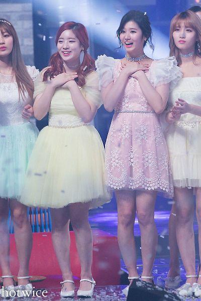 Tags: JYP Entertainment, K-Pop, Twice, Kim Dahyun, Jihyo, Hirai Momo, Minatozaki Sana, Frown, Yellow Outfit, Hairband, Four Girls, Hand On Chest