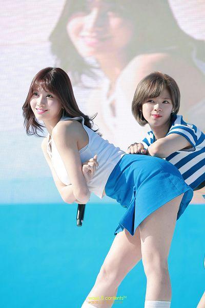 Tags: JYP Entertainment, K-Pop, Twice, Yoo Jeongyeon, Hirai Momo, Medium Hair, Striped, Blue Shirt, Bend Over, Looking Ahead, Microphone, Blue Skirt