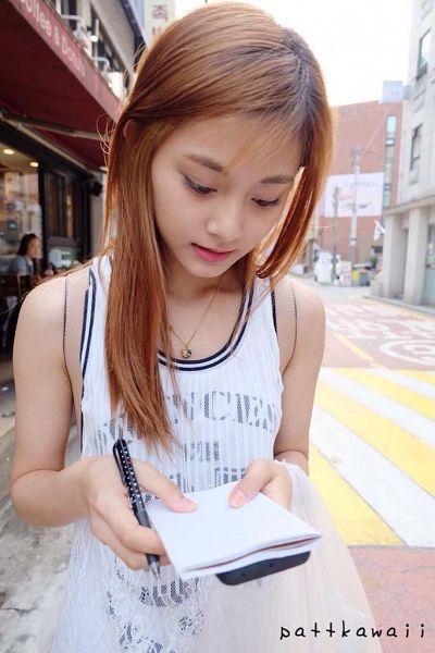 Tags: K-Pop, Twice, Tzuyu, Outdoors, Sleeveless Dress, White Dress, Pen, Sleeveless, Eyes Half Closed, Bare Shoulders, Reading, White Outfit