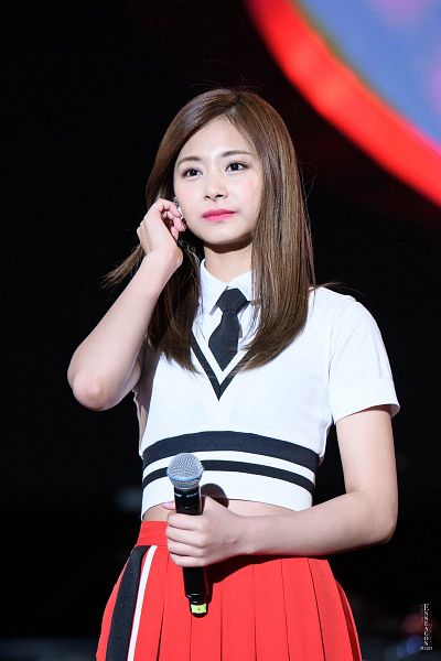 Tags: K-Pop, Twice, Tzuyu, Tie, Pleated Skirt, Skirt, Black Neckwear, Red Skirt, Looking Ahead, Midriff, Dark Background, Hand In Hair