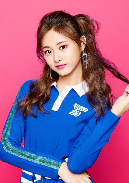 Tags: JYP Entertainment, K-Pop, Twice, One More Time, Tzuyu, Earrings, Blue Shirt, Crossed Arms, Closed Mouth, Wavy Hair, Pink Background