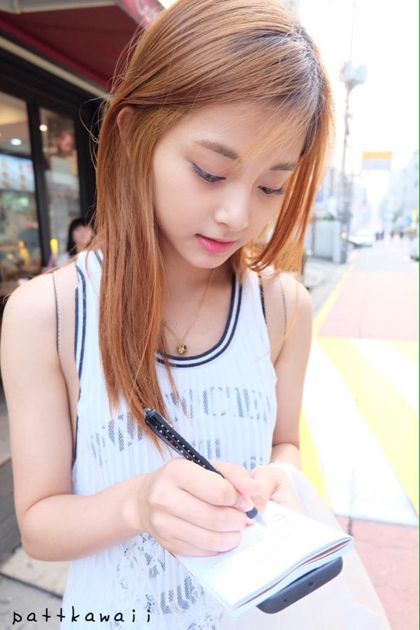 Tags: Television Show, K-Pop, Twice, Sixteen, Tzuyu, Sleeveless, Writing (Action), Necklace, Eyes Half Closed, Looking Down, Sleeveless Shirt, Bare Shoulders