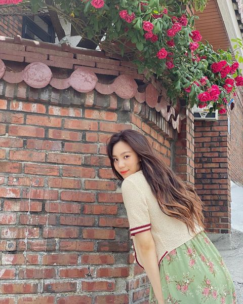 Tags: K-Pop, G-friend, Umji, Brick Background, White Outerwear, Looking Back, Outdoors, Floral Dress, Bend Over, Green Dress, Green Outfit, Floral Print