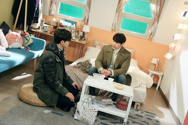 Tags: K-Drama, Lim Ju-hwan, Kim Woo-bin, Watch, Couch, Two Males, Wristwatch, Table, Bag, Looking At Another, Duo, Glasses