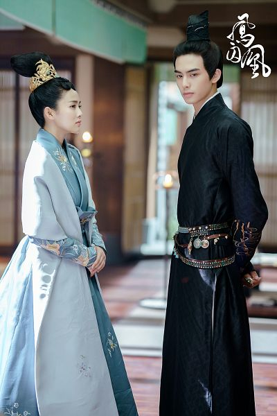 Tags: C-Drama, Song Weilong, Bai Lu, Black Outfit, Text: Series Name, Blue Dress, Looking At Another, Arms Behind Back, Blue Outfit, Black Dress, Hair Ornament, Duo