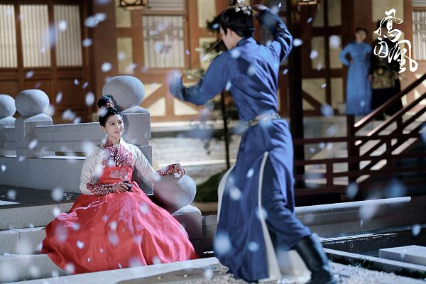 Tags: C-Drama, Song Weilong, Guan Xiaotong, Looking At Another, Dancing, Blue Outfit, Text: Series Name, Shoes, Couple, Duo, Petals, Belt