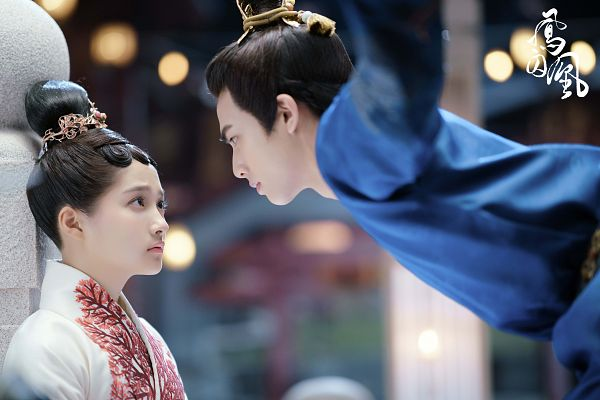 Tags: C-Drama, Song Weilong, Guan Xiaotong, Duo, Text: Series Name, Looking At Another, Chinese Text, Traditional Clothes, Hair Ornament, Blue Dress, Single Bun, Dancing