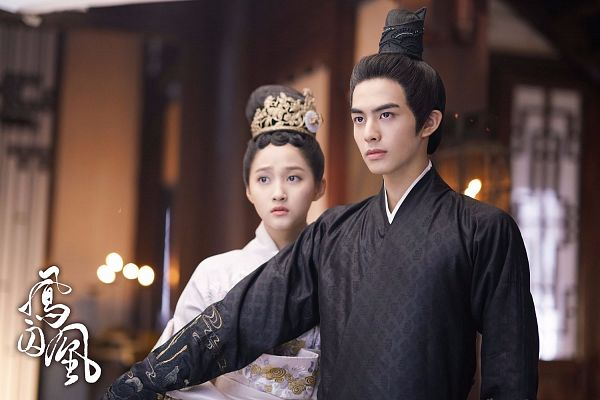 Tags: C-Drama, Song Weilong, Guan Xiaotong, White Outfit, Chinese Clothes, Couple, Black Outfit, Chinese Text, Black Dress, Text: Series Name, Duo, White Dress