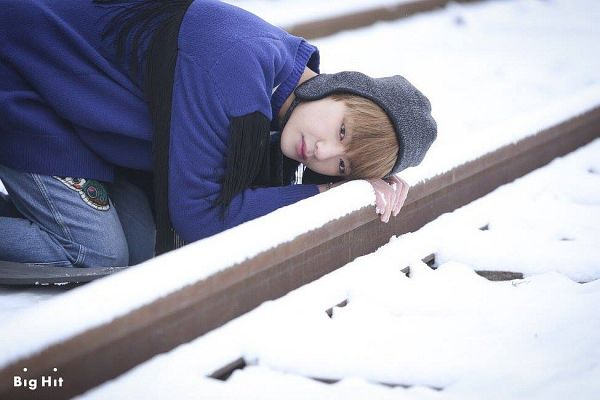 Tags: K-Pop, BTS, Spring Day, V (Kim Taehyung), Black Headwear, Blue Jacket, Snow, Jeans, Railroad Tracks, Blue Pants, Hat, Blue Outerwear