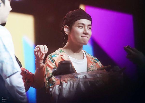 Tags: K-Pop, BTS, V (Kim Taehyung), Floral Jacket, Earbuds, Orange Outerwear, Black Headwear, Floral Print, Hat