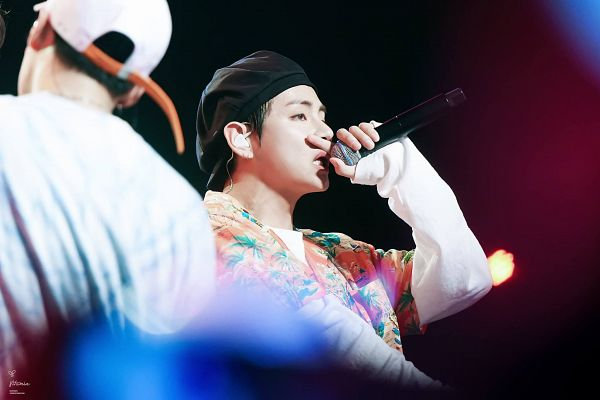 Tags: K-Pop, BTS, V (Kim Taehyung), Floral Print, Floral Jacket, Hat, Earbuds, Singing, Orange Outerwear, Black Headwear