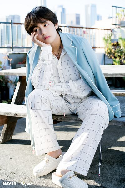 Tags: K-Pop, BTS, V (Kim Taehyung), Plaided Print, Necklace, City, Table, White Pants, Outdoors, Hand On Cheek, White Footwear, Sky