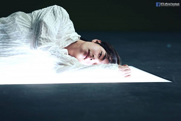 Tags: K-Pop, BTS, Singularity, V (Kim Taehyung), Text: URL, Laying On Side, Laying On Ground, English Text, Contact Lenses, Dark Background, Laying Down, Text: Artist Name