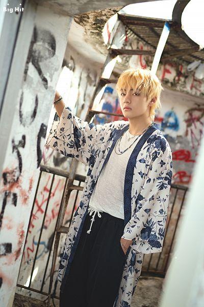 Tags: K-Pop, BTS, V (Kim Taehyung), Hand In Pocket, Coat, Open Coat, Necklace, Dutch Angle, Black Pants, Bracelet, Text: Company Name, English Text