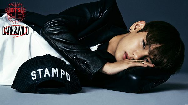 Tags: K-Pop, BTS, V (Kim Taehyung), Laying Down, Black Headwear, Leather Jacket, Text: Artist Name, Hat, Text: Album Name, Blue Background, Baseball, Laying On Side