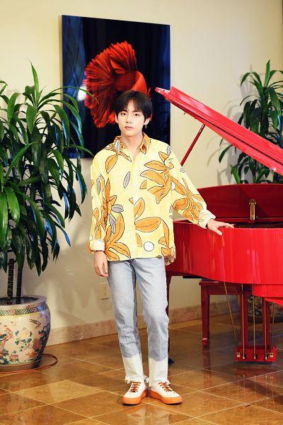 Tags: K-Pop, BTS, V (Kim Taehyung), Floral Shirt, Vase, Floral Print, Piano, Indoors, Gray Pants, Yellow Shirt, Canvas, Plant