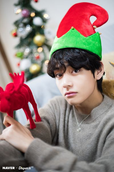 Tags: K-Pop, BTS, V (Kim Taehyung), Serious, Black Eyes, Christmas Hat, Necklace, Gray Shirt, Sitting On Ground, Hat, Sweater, Christmas