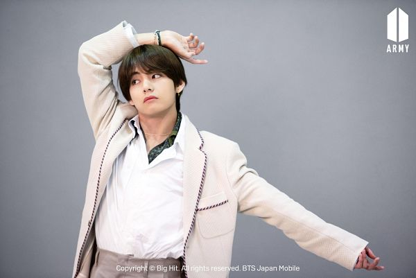 Tags: K-Pop, BTS, V (Kim Taehyung), Brown Pants, Looking Away, White Jacket, Bracelet, One Arm Up, Gray Background, White Outerwear