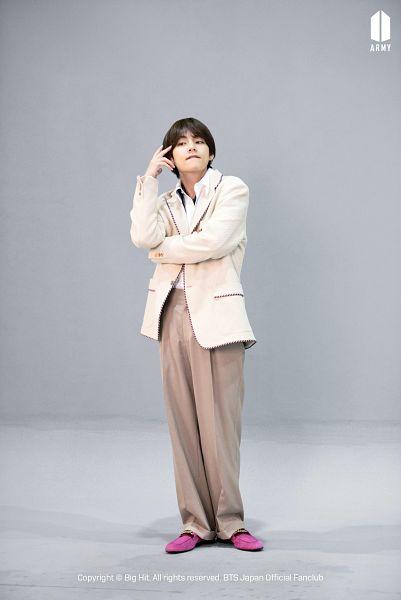 Tags: K-Pop, BTS, V (Kim Taehyung), Gray Background, Pink Footwear, Brown Pants, White Outerwear, White Jacket, Biting Lip