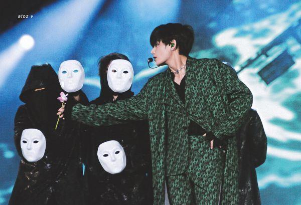 Tags: K-Pop, BTS, Singularity, V (Kim Taehyung), Headdress, Green Pants, Mask, Looking Away, Dancing, Green Outfit, Earbuds, Flower