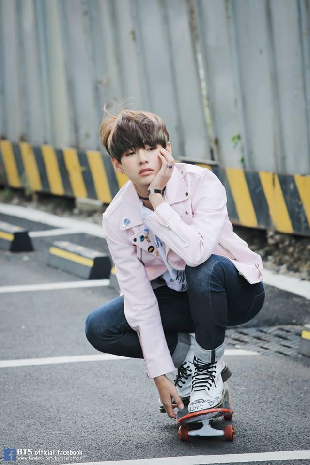 Tags: K-Pop, BTS, V (Kim Taehyung), Black Pants, Pink Outerwear, Crouching, Hand On Cheek, Skateboard, Ring, White Footwear, Jeans, Pink Jacket
