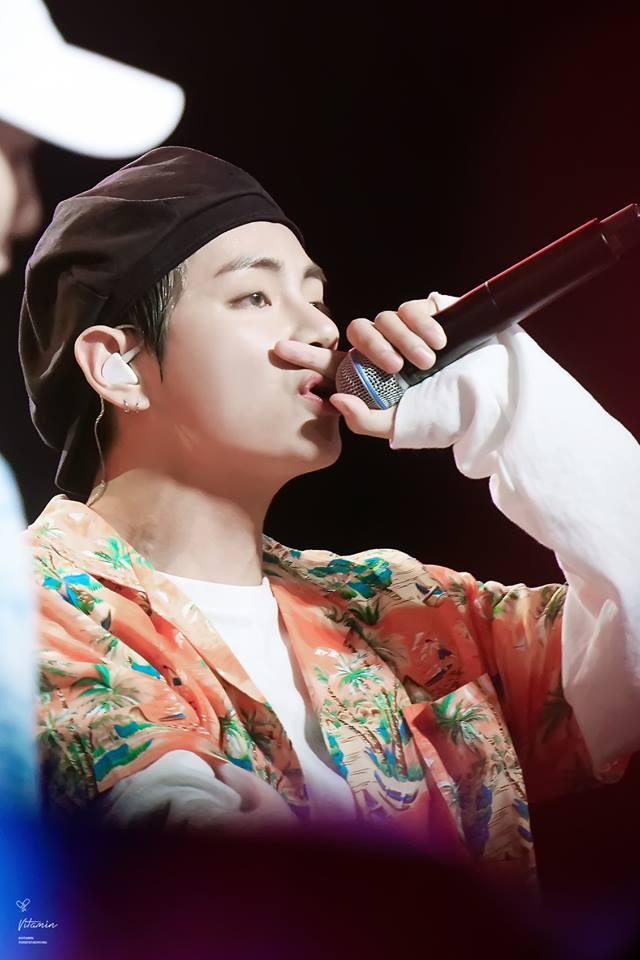 Tags: K-Pop, BTS, V (Kim Taehyung), Floral Jacket, Hat, Earbuds, Singing, Orange Outerwear, Black Headwear, Floral Print