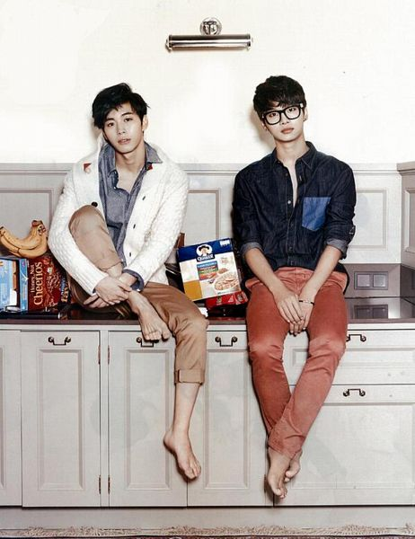 Tags: K-Pop, VIXX, Hongbin, N (singer), Barefoot, Brown Pants, Kitchen, Table, Two Males, Sitting On Table, White Jacket, Denim Shirt