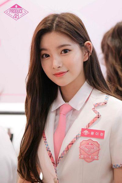 Tags: K-Pop, Everglow, Wang Yiren, School Uniform, Pink Background, Uniform, White Jacket, Tie, Text: Series Name, Korean Text, Pink Neckwear, White Outerwear
