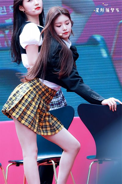 Tags: K-Pop, Everglow, Wang Yiren, Chair, Black Outerwear, Yellow Skirt, Black Jacket, Pleated Skirt, Eyes Closed, Checkered Skirt, Skirt, Checkered