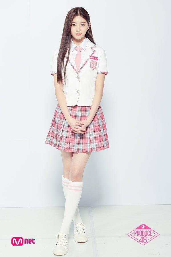 Tags: Television Show, K-Pop, Everglow, Wang Yiren, Korean Text, White Background, Checkered Skirt, Pink Skirt, Shoes, White Footwear, Pink Neckwear, Knee Socks