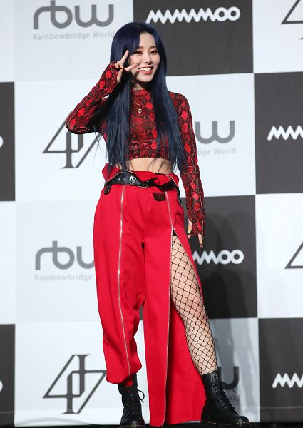 Tags: K-Pop, Mamamoo, Wheein, V Gesture, Red Shirt, Light Background, Red Pants, Necklace, White Background, Dark Background, Text: Company Name, Boots