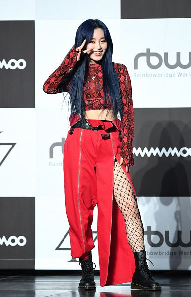 Tags: K-Pop, Mamamoo, Wheein, Boots, Red Shirt, White Background, Dark Background, Text: Company Name, Text: Artist Name, Looking Away, Hand On Leg, Checkered