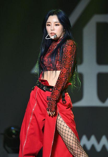 Tags: K-Pop, Mamamoo, Wheein, Belt, Bare Legs, Red Shirt, Red Pants, Dark Background, Midriff, Pantyhose, Fishnets, Black Background