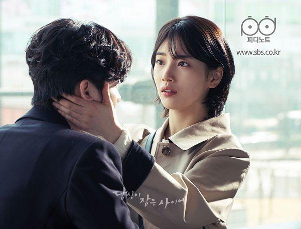 Tags: JYP Entertainment, K-Pop, K-Drama, Lee Jong-suk, Bae Suzy, Korean Text, Duo, Looking At Another, Hand On Cheek, Serious, Black Eyes, Coat