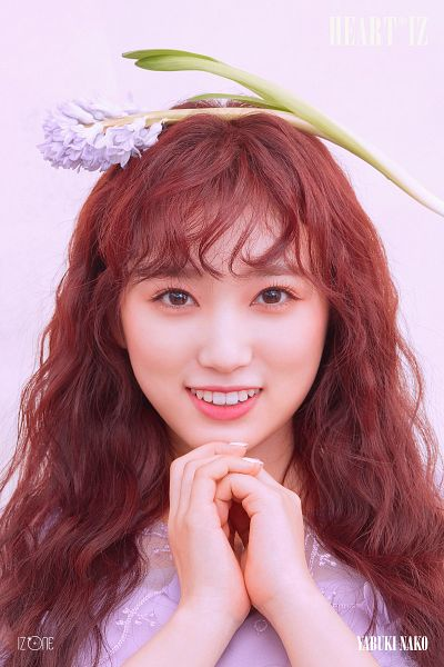 Tags: K-Pop, J-Pop, IZ*ONE, HKT48, Yabuki Nako, Blush (Make Up), Red Hair, Pink Background, Purple Hair, Grin, Text: Artist Name, Make Up