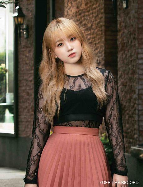 Tags: K-Pop, J-Pop, IZ*ONE, HKT48, Yabuki Nako, Pink Skirt, Serious, Black Shirt, Head Tilt, Blonde Hair, Skirt, See Through Clothes