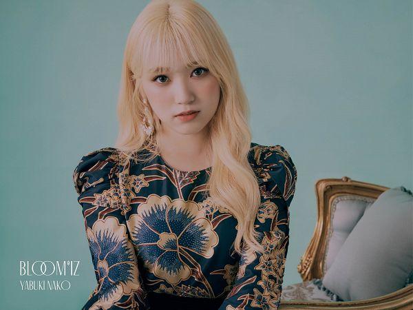 Tags: K-Pop, J-Pop, IZ*ONE, HKT48, Yabuki Nako, Text: Artist Name, Blue Background, Text: Album Name, Serious, Pillow, Blonde Hair