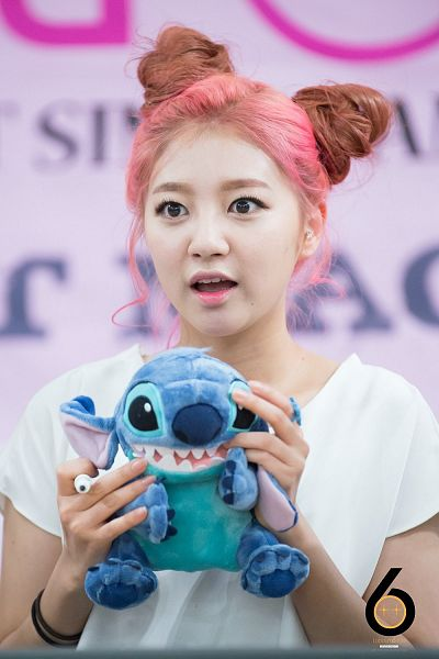 Tags: K-Pop, Laboum, Yeom Haein, Looking Ahead, Holding Object, Stuffed Toy, Black Eyes, Hair Up, Bracelet, Hair Buns, Twin Buns, Toy