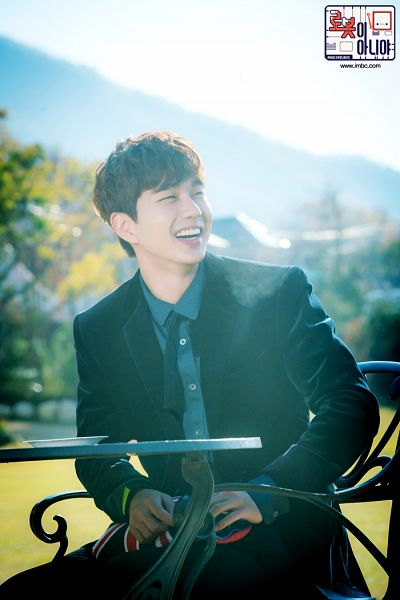 Tags: K-Drama, Yoo Seung-ho, Table, Blue Shirt, Sitting On Chair, Bent Knees, Jacket, Black Outerwear, Black Jacket, Tie, Laughing, Chair