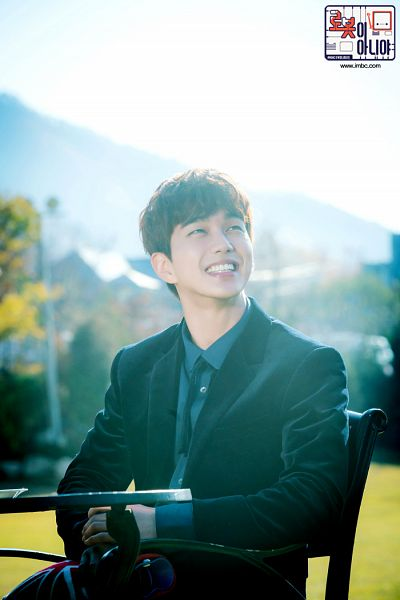Tags: K-Drama, Yoo Seung-ho, Black Jacket, Black Outerwear, Sitting On Chair, Tie, Korean Text, Chair, Text: Series Name, Blue Shirt, Table, I'm Not a Robot